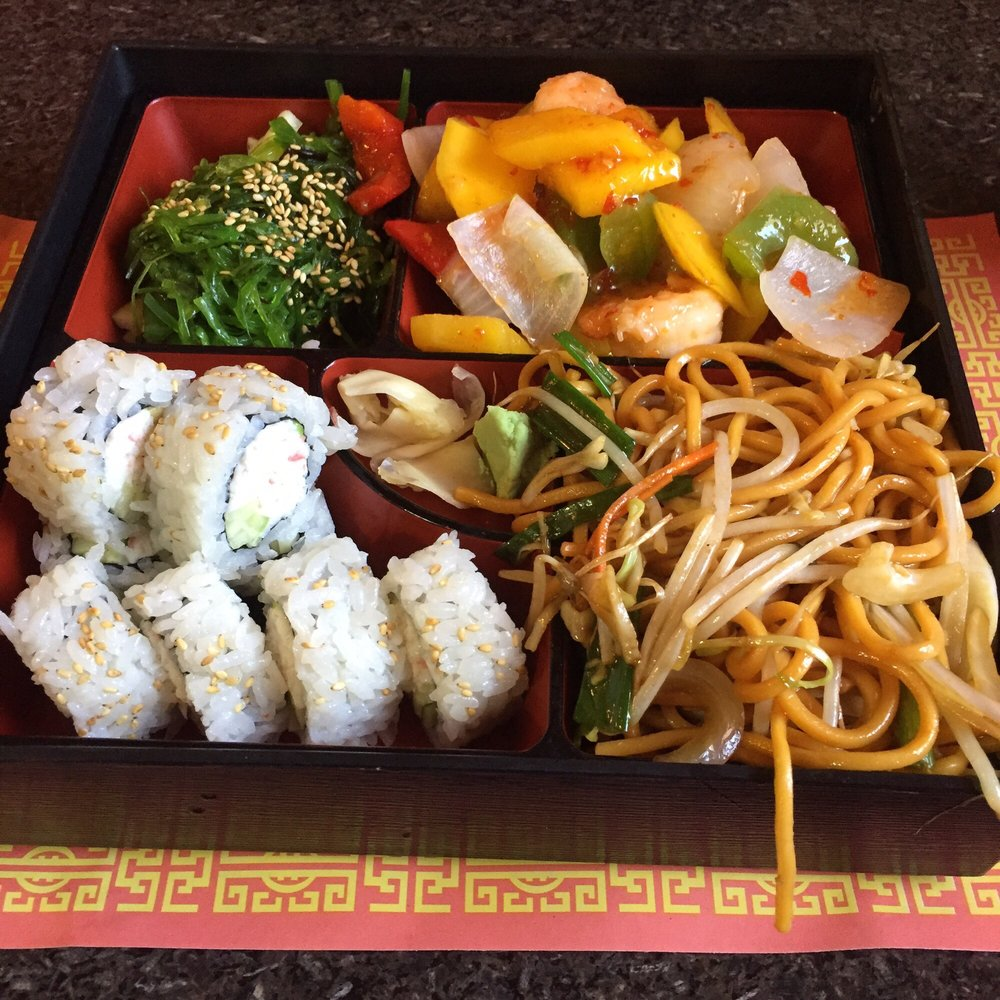 Bento box lunch with mango shrimp, lo mein, California roll, and ...