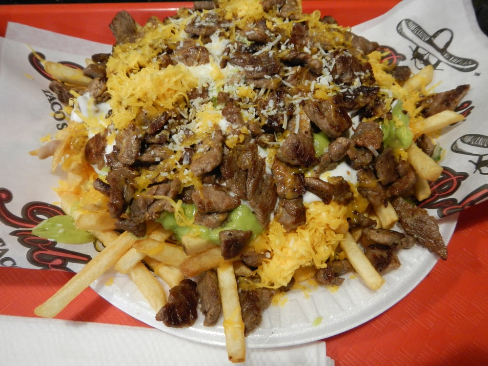 Carne asada fries - French fries, refried beans, guacamole ...