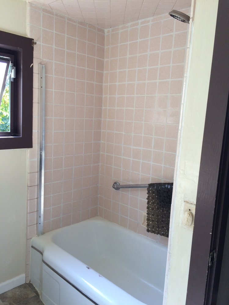 BEFORE : peach tile, rusty tub and old shower door framing - Yelp