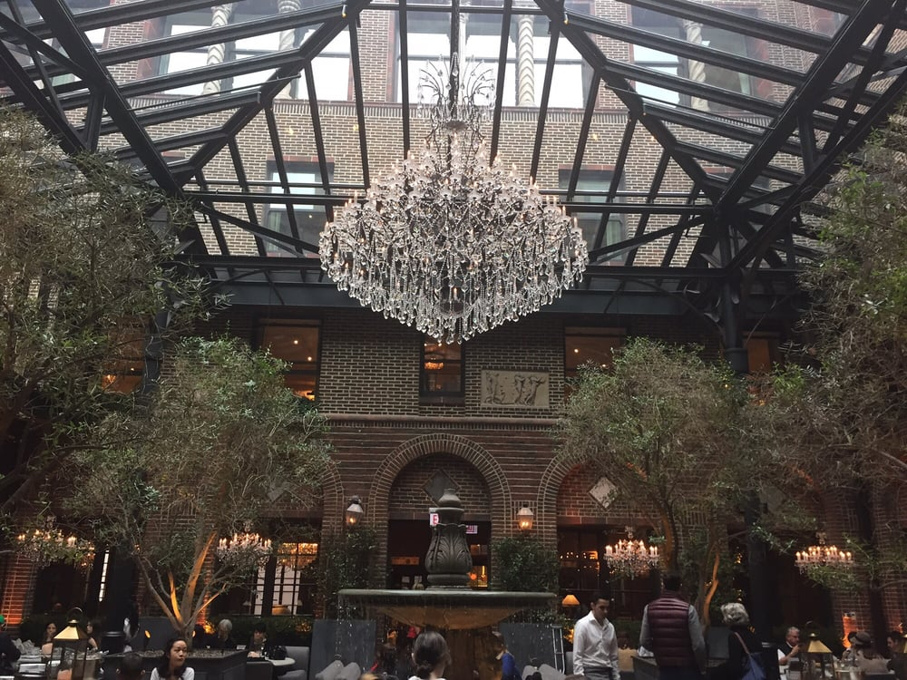 Wow! Check out the chandelier and trees and the water fountain - Yelp