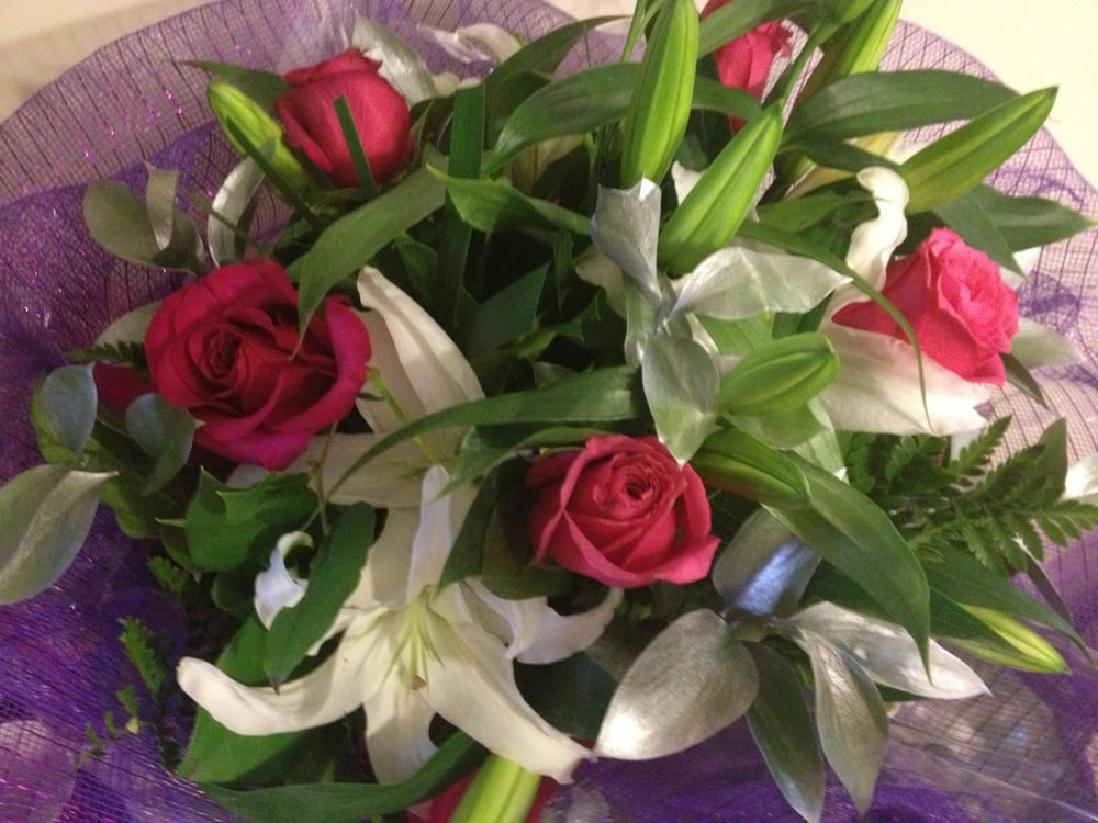 $20 for the bouquet and $3 for the purple mesh. They can make any ...
