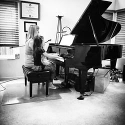 our daughter taking piano lessons in oceanside at lenoremusic