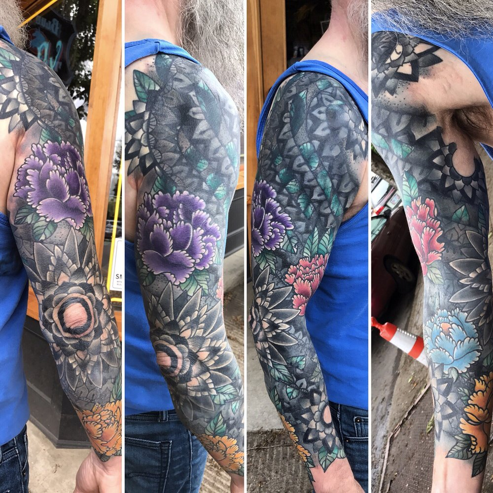 A cover up filled with mandalas, henna designs and peonies. A ...