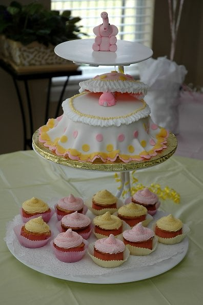Baby Shower Cakes Made With Buttercream Icing ~ This baby shower cake is covered with fondant cup cakes
