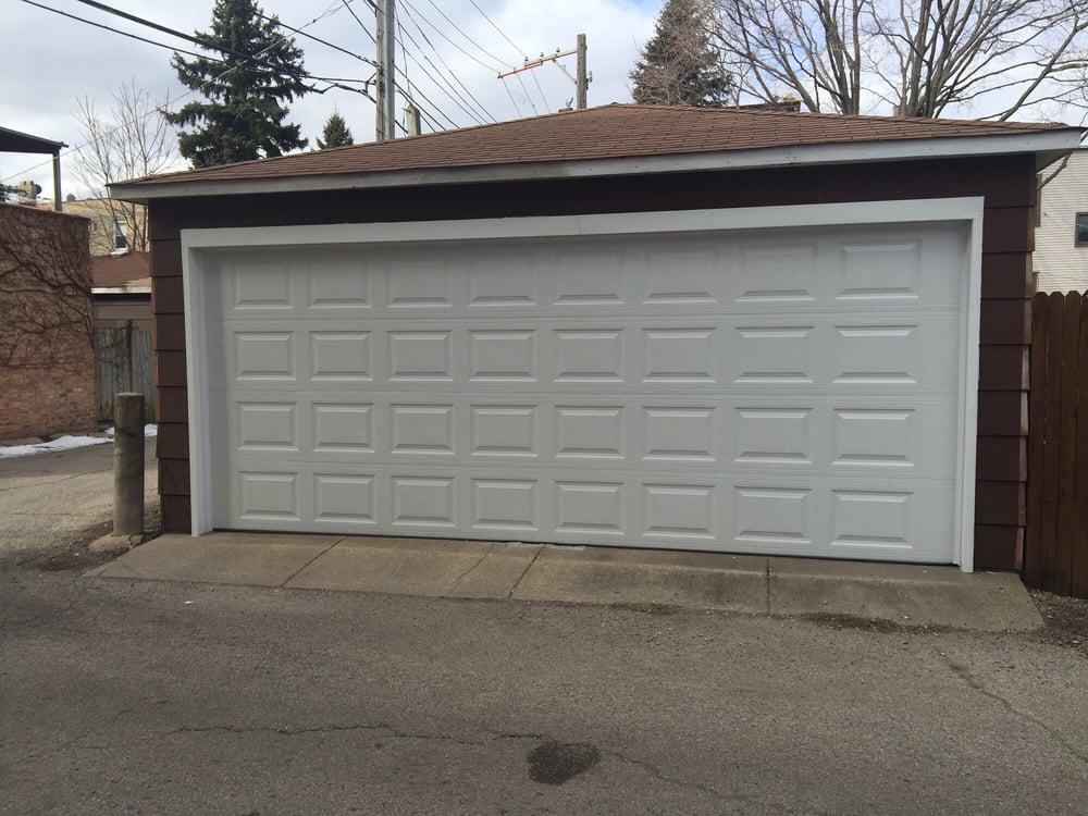 We expanded 2 8x7 garage doors into one 18x7 garage door - Garage door vinyl wrap ...