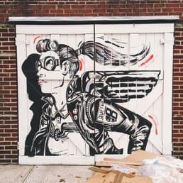 photo of tar pit garage door murals brooklyn ny united states