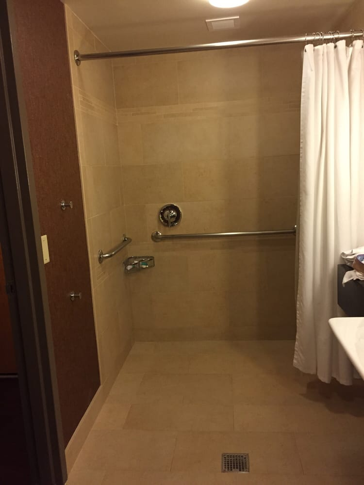 Handicap access shower with no lip ( should block of part of water ...