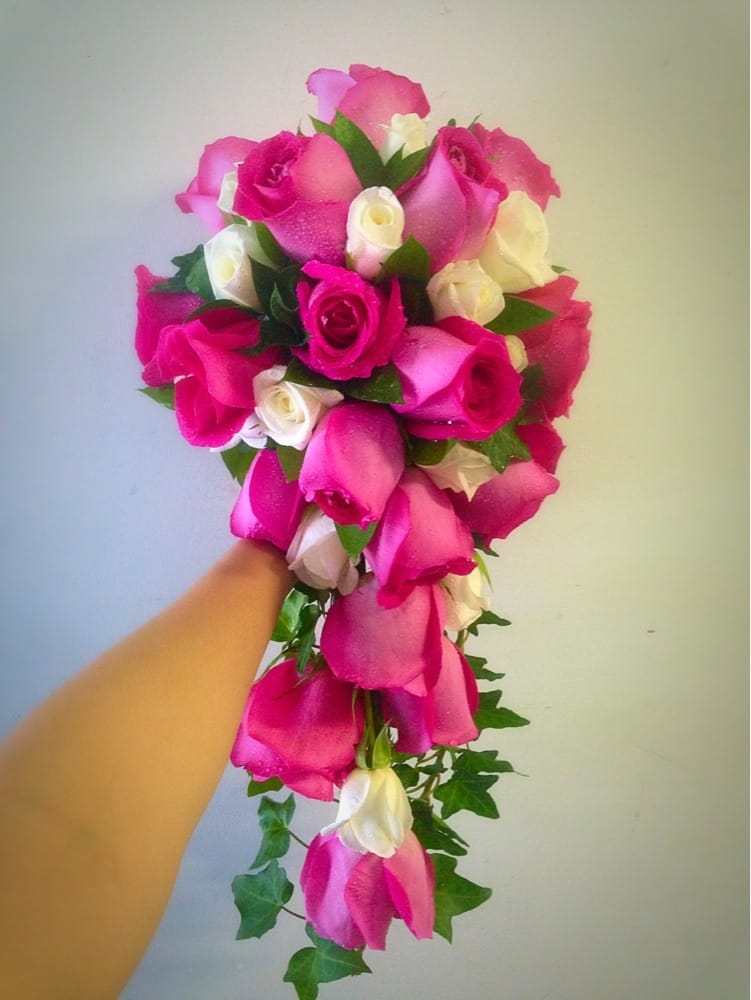 Cascading bridal bouquet. Hot pink roses, mini white roses, ivy, and ...