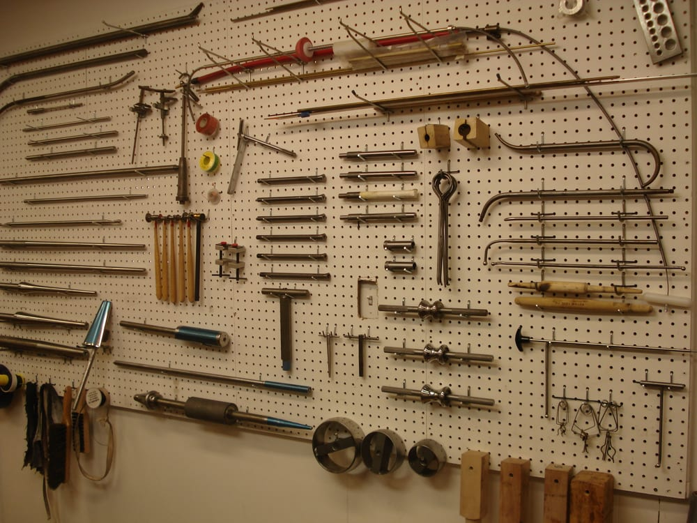 A Small Array Of Tools Used To Repair Brass Instruments
