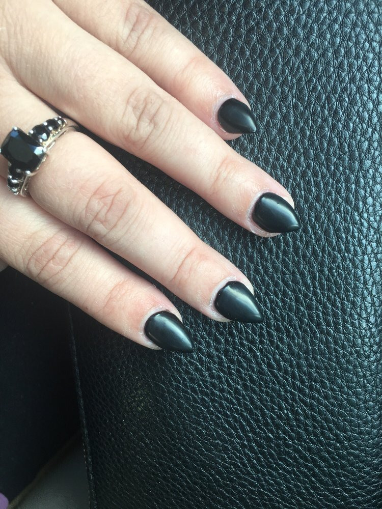 Matte black full acrylic set. Done by Tom. So happy with them. - Yelp