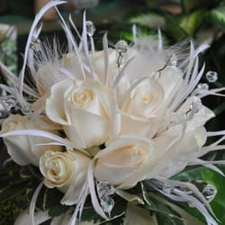 Photo of A Country Rose - Henderson, NV, United States. White feathers and