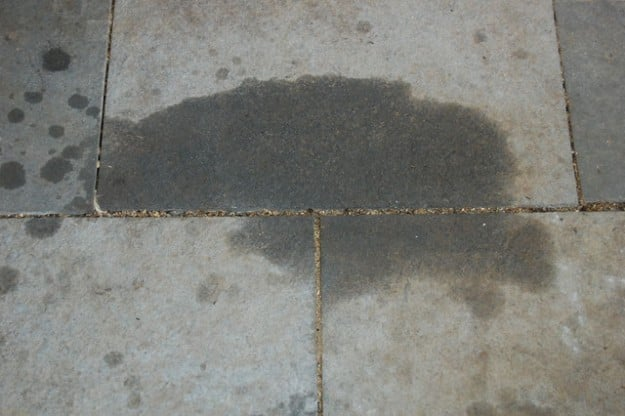 Oil and grease stains don 39 t just make a garage floor look for Steam clean garage floor
