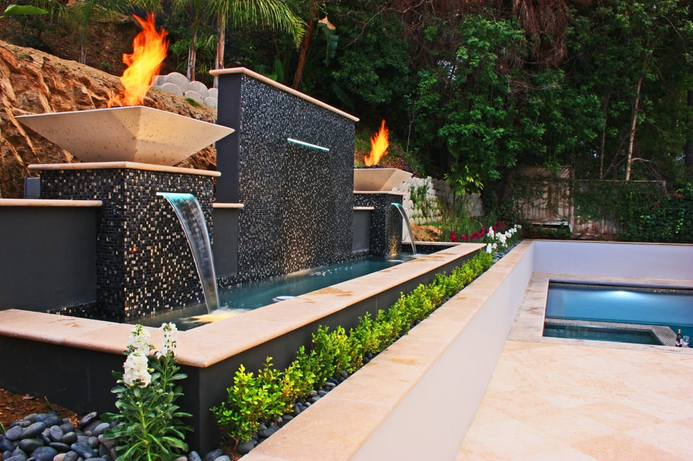 Lighting Basement Washroom Stairs: Fire Feature With Waterfall And Paving Stone Patio