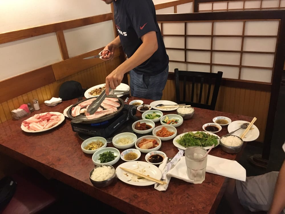 My korean friend working the grill yelp for Asiana korean cuisine restaurant racine