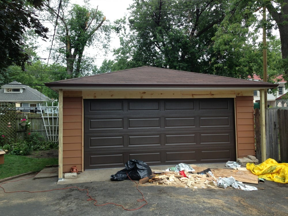 New 4 12 pitch hip roof with a 2 39 ft overhang new gutters for Garage ww auto