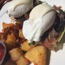The Hudson House - Nyack, NY, United States. Eggs Benedict with prosciutto, portobello, arugula, and a delicious truffle vinaigrette