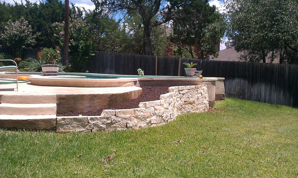 This A Retaining Wall Done On A Back Side Of A Pool For A