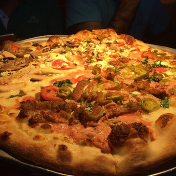 Photo of Tomasino's Pizza - Orlando, FL, United States. Half Don Tomasino/half Chicken Mediterranean: Yumm! Don Tomasino was crowd pleaser