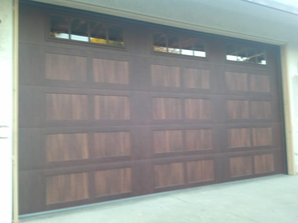 Chi Accent Garage Door Two Tone Wood Stain And Glass Yelp