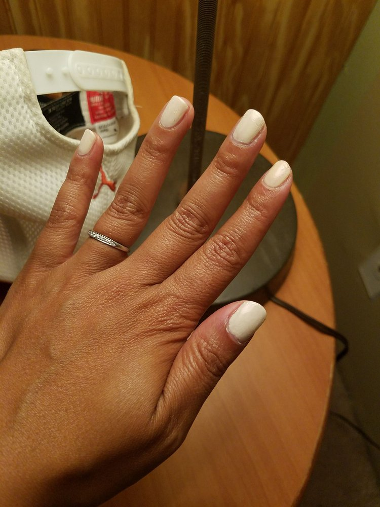 Look at that poor looking gel mani.. Doesnt cover entire nail. Dents ...