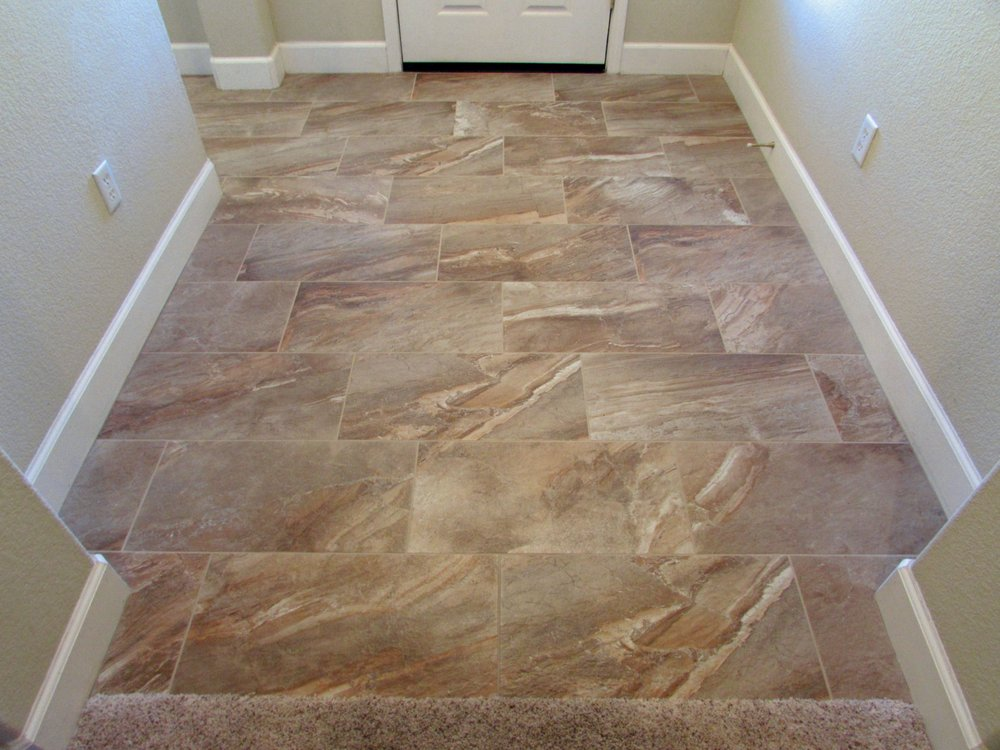 Completely new 12 x 24 porcelain tile on a 1/3 offset pattern - Yelp XP37
