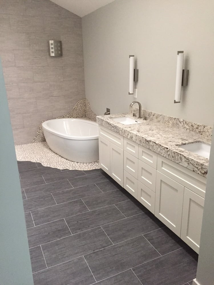 Bamboo grey color porcelain 12x24 tile, pebble rock tiles around tub ...