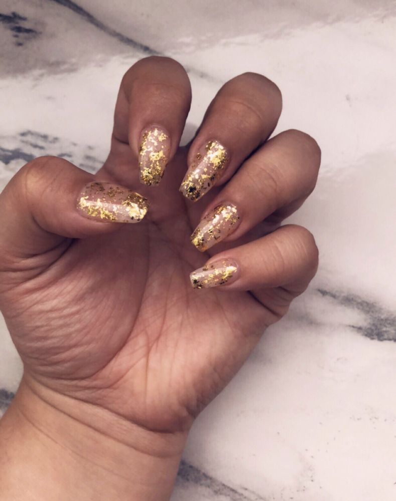 Gold flakes on a pink clear gel polish - Yelp