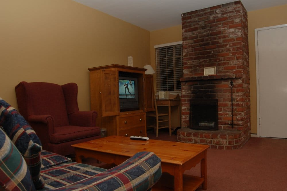 deluxe room came with fireplace direct tv desk couch. Black Bedroom Furniture Sets. Home Design Ideas