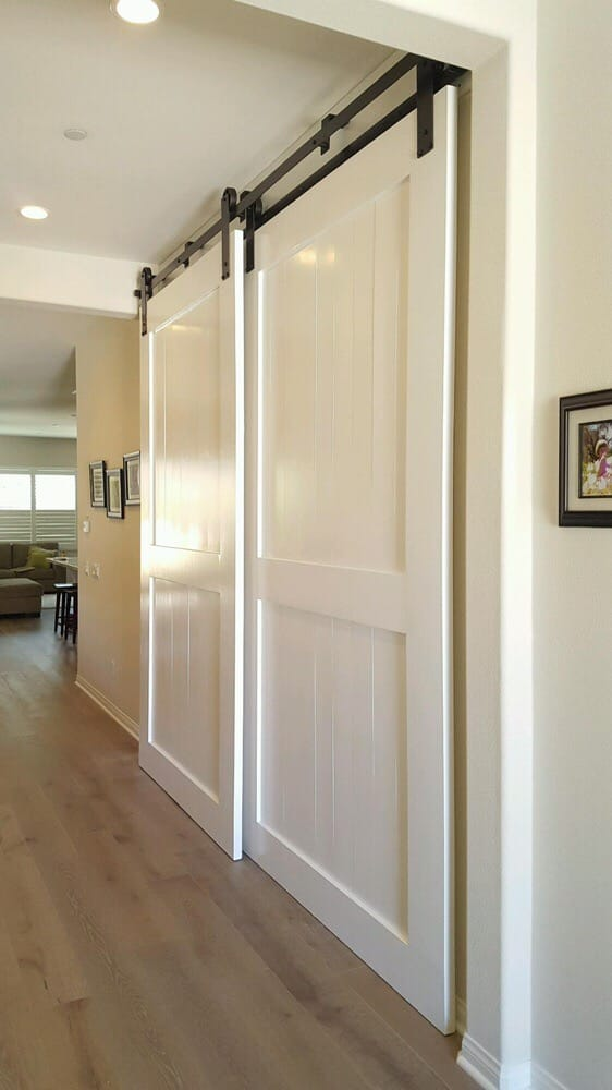 White Double Barn Doors with Bypass Hardware for a den. - Yelp