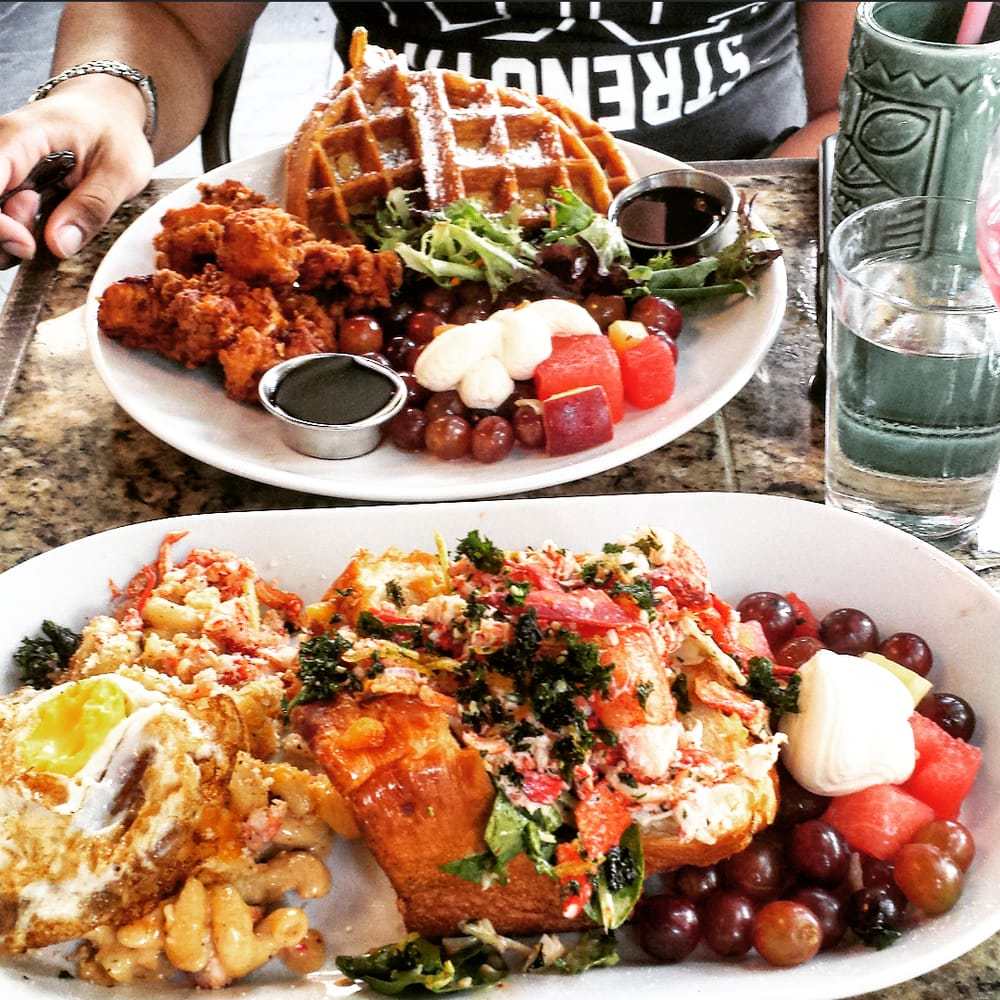 Poor Calvin's Lobster Roll with Lobster mac n' cheese and a sweet potato waffle with fried ...