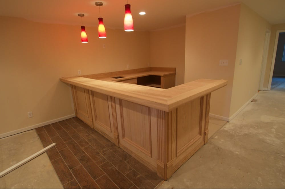 Oak wet bar in a basement remodel yelp for Wet bar construction plans