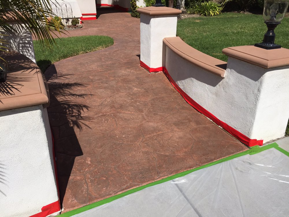 Stamped concrete driveway restoration project before