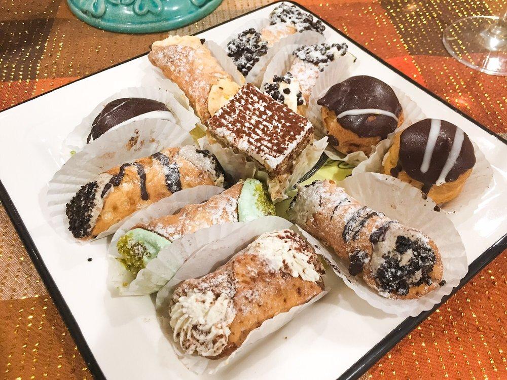 assorted pastries chocolate chip cannoli oreo cannoli pumpkin