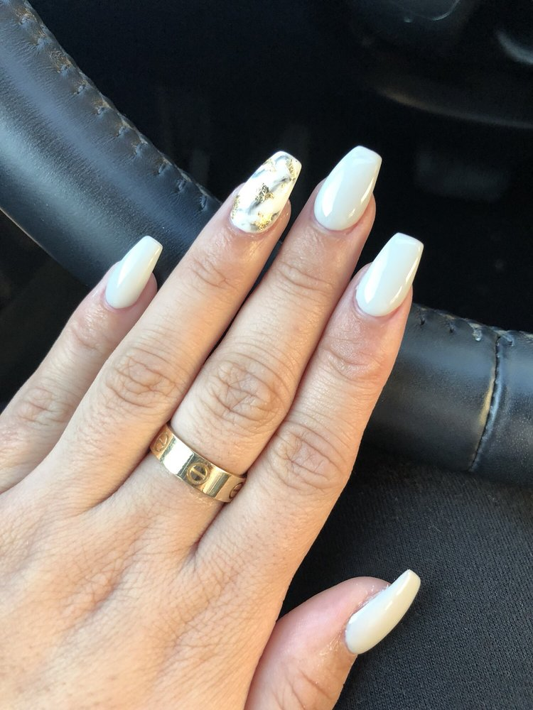 Marble design on ring finger w/ gold flakes. Gel color on the rest ...