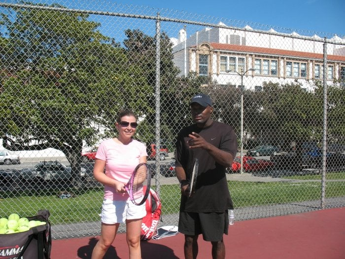 Tennis Lessons By Mcclain - San Francisco, CA, United States. Tlking with a client