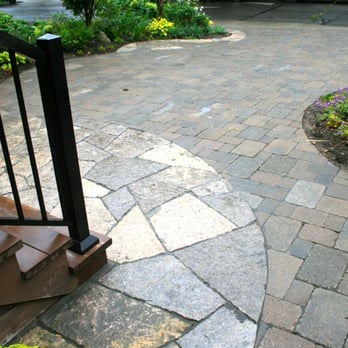front yard parking pad with tumbled interlocking brick pavers and