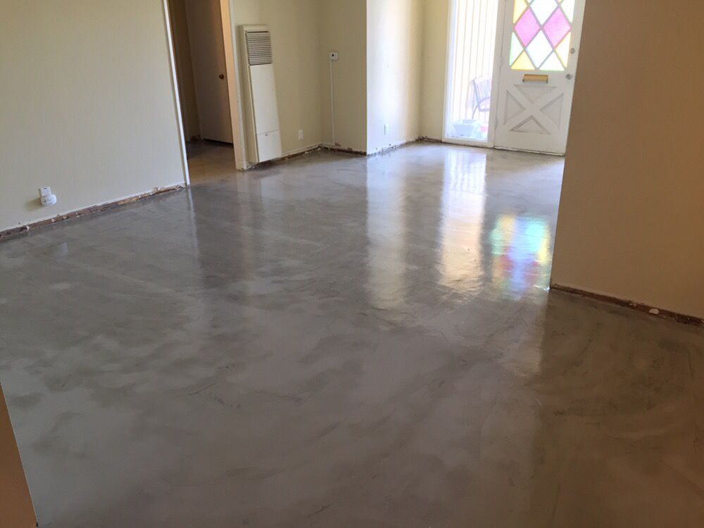 Installed micro topping grey with semi gloss sealer over for Microtopping costi