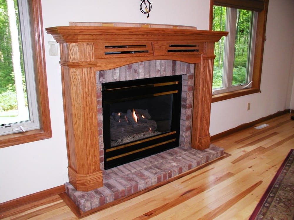 Recessed Mantel Package With Brick Wall Surround And Base And Gas