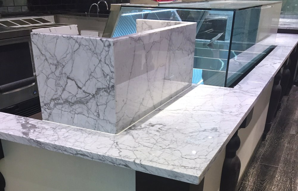 Top off your sneeze guard with White Carrara marble for a