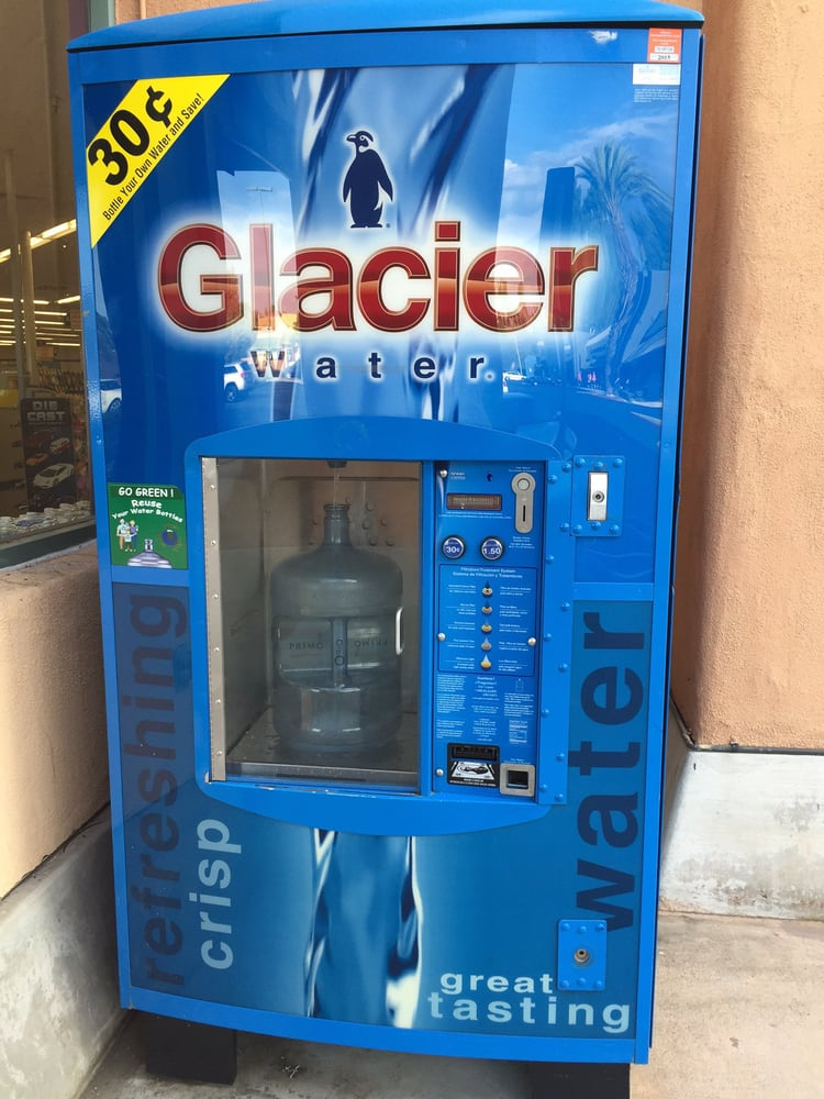 A Glacier Water Dispenser Machine right outside the door ...