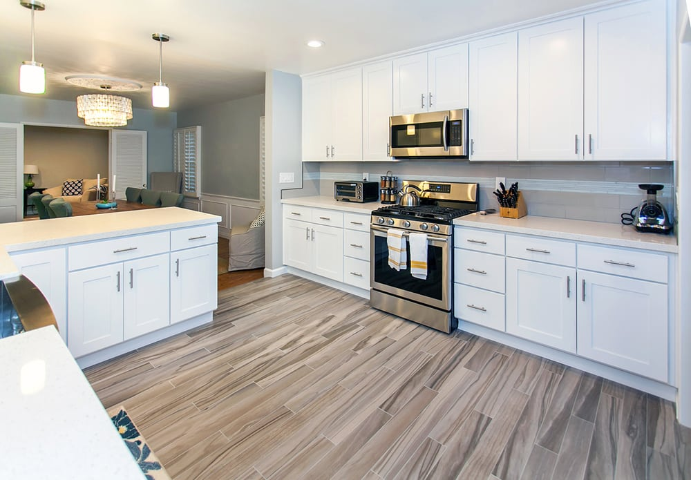 kitchen cabinets van nuys wood looking porcelain tile in a white shaker kitchen 6435