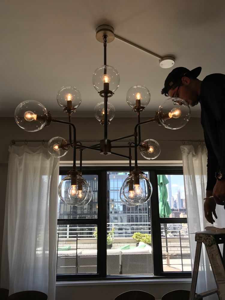 Chandelier installations in luxury homes - Yelp