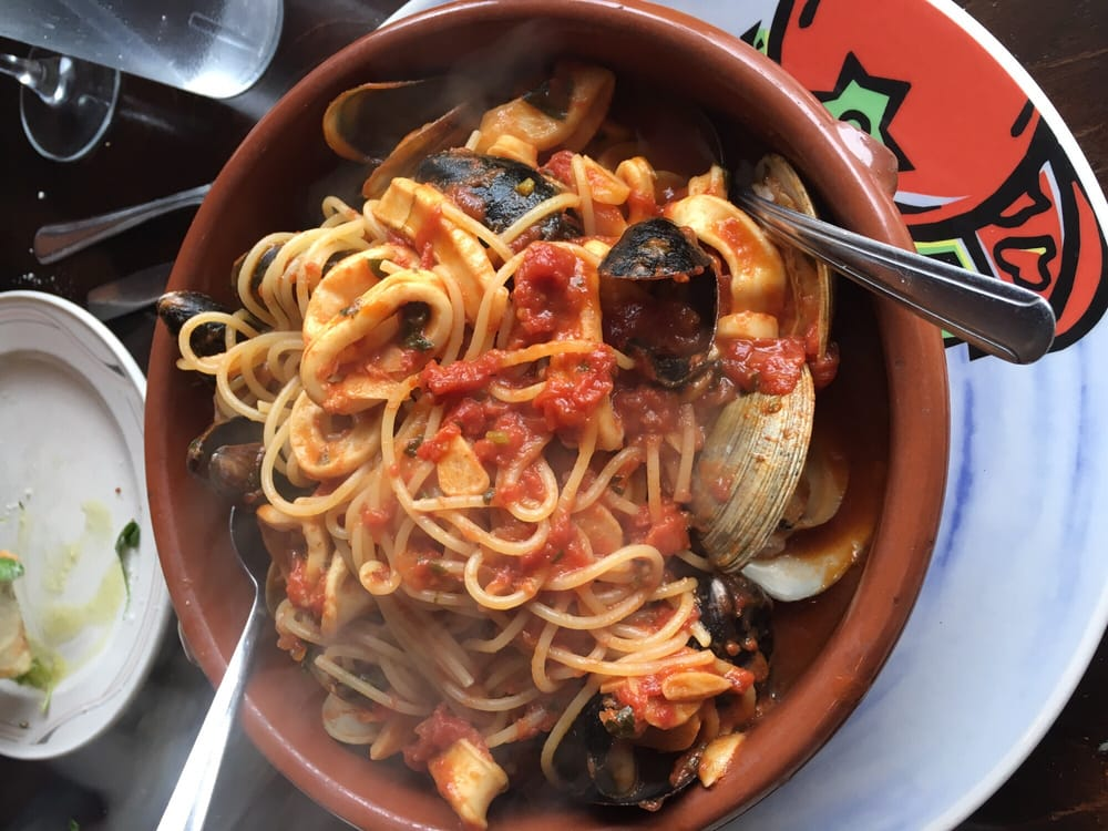 Photo of Trattoria La Sorrentina - North Bergen, NJ, United States. Spaghetti ai sapori di mare. Mixed seafood w pasta in tomato sauce. Served fresh, hot, and delicious.  Yum