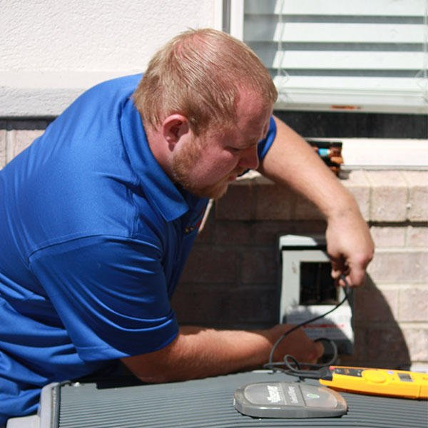 Black Diamond Air Conditioning Technician Fixing An Air