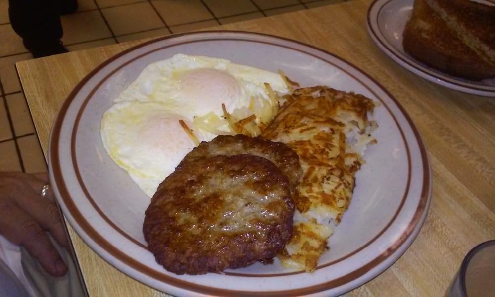 Eggs (over easy) sausage patties, hash browns. - Yelp