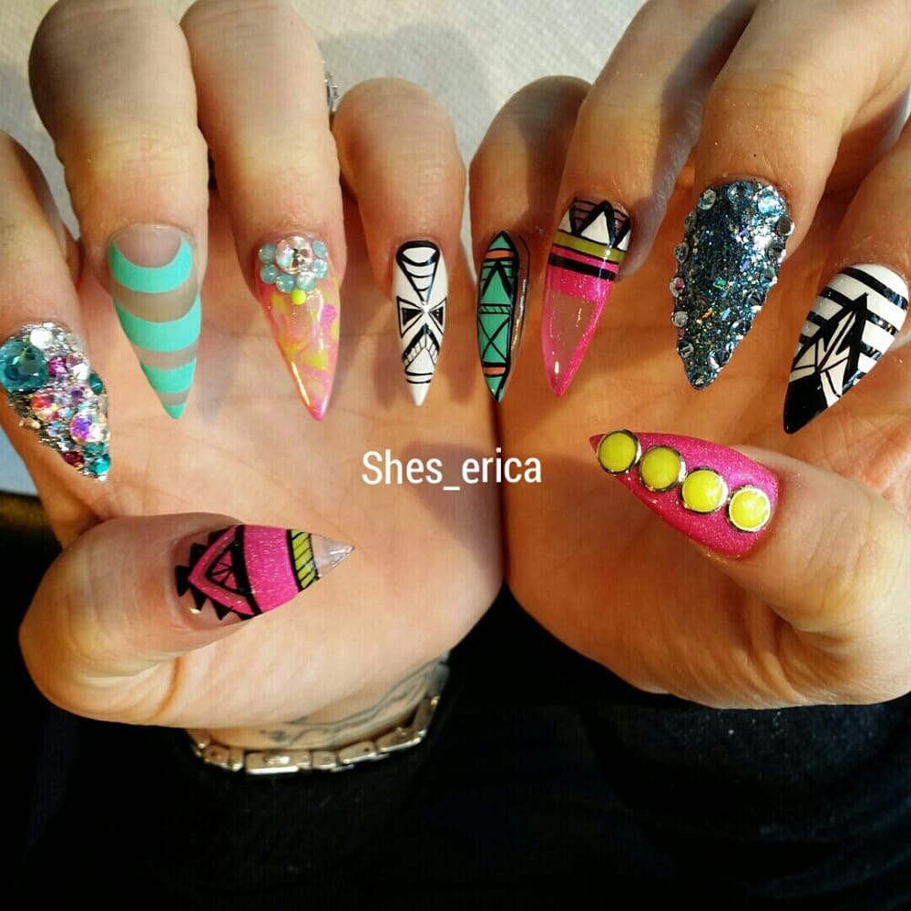 Stiletto nails with freestyle hand painted designs. - Yelp