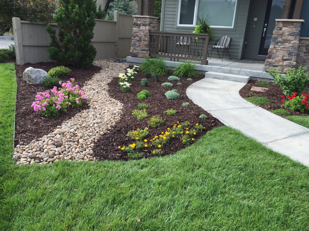 1 5 river rock cherry brown mulch yelp for Brown lava rock for landscaping
