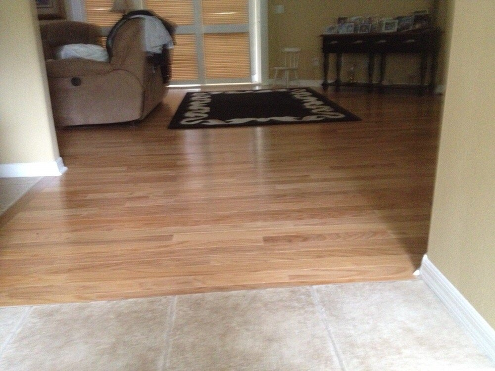 Oak Wood Flooring Installed With No T Molding At Tile