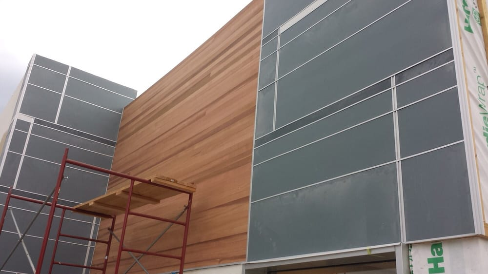 We combined a natural wood with Hardie panel and channel to