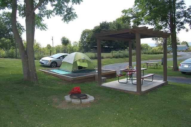 A Campsite With Gravel Pad Fire Pit Picnic Table Mesh Canopy - Fire picnic table